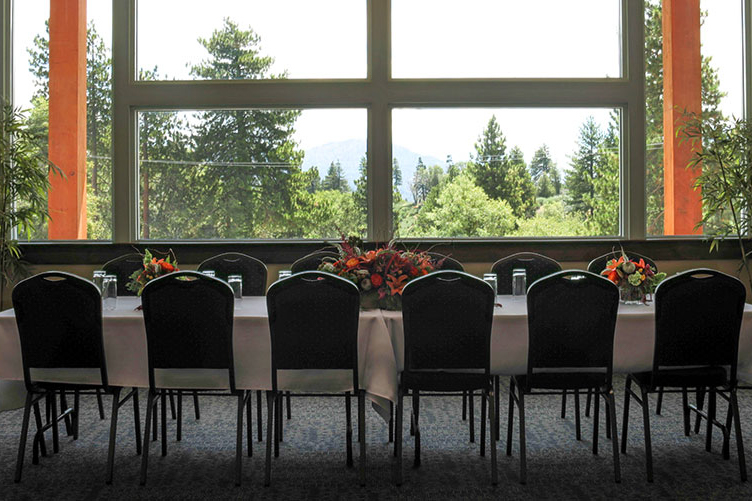 a dining room table set up for a function