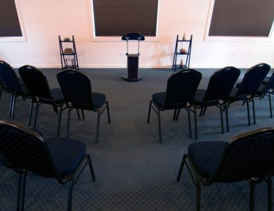 conference chairs arranged in front of a podium
