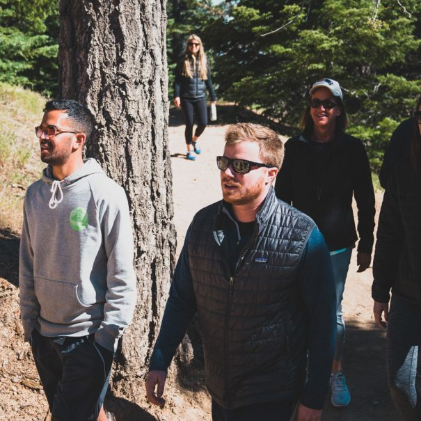 people walking along a mountain trail
