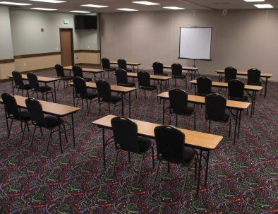 chairs and tables set up in a conference room