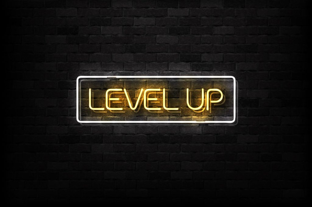 "a sign that reads ""level up"""