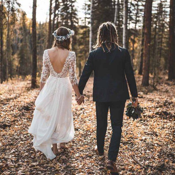 A bride and groom in the forest